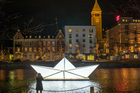 education in sweden: Norrkoping, Sweden - December 20, 2015: Illuminated boat in Motala stream in Norrkoping. Norrkoping, a historic industrial town and a center of education, is illuminated during Christmas time.