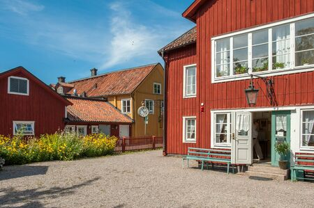 holiday house: Mariefred, Sweden - August 4, 2011: Vintage buildings in idyllic small town Mariefred. This historic town on Lake Malaren is a popular tourist destination