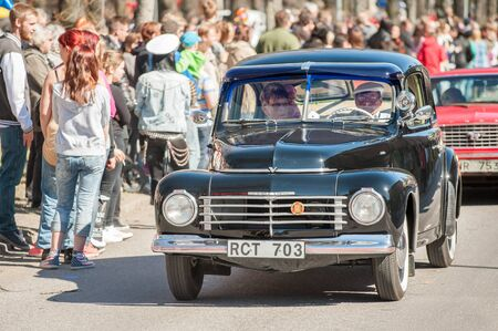 become: Norrkoping, Sweden - May 1, 2013: Volvo PV 444 1947 at the classic car parade celebrating spring on May Day in Norrkoping. This parade started in 1974 and has become an annual tradition in Norrkoping on May 1. Editorial