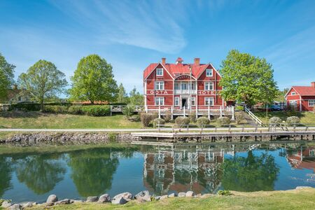 contributes: Borensberg, Sweden - May 12, 2016: Gota Canal and Gota Hotel during spring in Borensberg. The canal contributes to a 390 km long waterway with 58 locks connecting the Swedish west coast with the east coast.