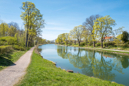 Göta Canal at Berg outside Linköping during spring in Sweden. The canal contributes to a 390 km long waterway with 58 locks connecting the Swedish west coast with the east coast.