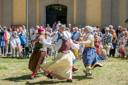 scandinavian people: Norrkoping, Sweden - June 6, 2016: Swedish folk dance during National day celebration in the Olai Park of Norrkoping. Norrkoping is a historic industrial town in Sweden. Editorial