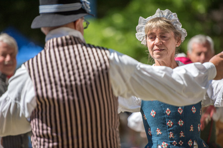 folk dance: Norrkoping, Sweden - June 6, 2016: Swedish folk dance during National day celebration in the Olai Park of Norrkoping. Norrkoping is a historic industrial town in Sweden. Editorial