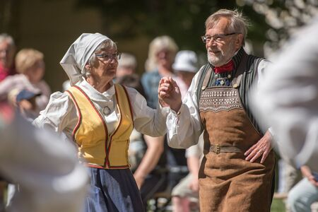 industrial park: Norrkoping, Sweden - June 6, 2016: Swedish folk dance during National day celebration in the Olai Park of Norrkoping. Norrkoping is a historic industrial town in Sweden. Editorial