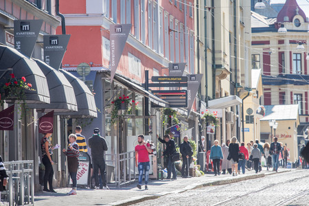 lunchtime: Norrkoping, Sweden – September 16, 2015: Norrkoping city center and main street Drottninggatan during lunchtime. Norrkoping is a historic industrial town.