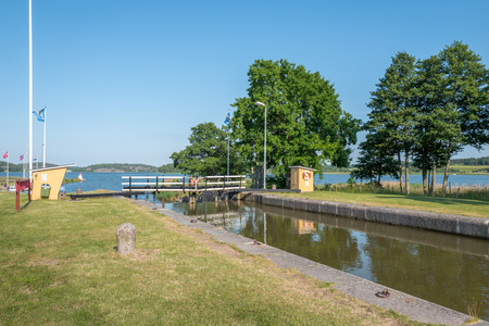 canal lock: Mem, Sweden - June 25, 2016: The first lock at Gota Canal during midsummer in Sweden. Mem is the gate to Gota Canal from the Baltic sea on the east coast of Sweden.