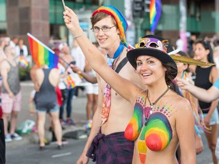despite: Stockholm, Sweden - July 30, 2016: Stockholm Pride Parade was followed by almost half a million spectators despite mixed weather. The Stockholm Pride festival has been held annually since 1998
