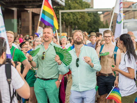 Stockholm, Sweden - July 30, 2016: Politician Fredrick Federley and Centerpartiet participated in Stockholm Pride Parade 2016, which  was followed by almost half a million spectators. The Stockholm Pride festival has been held annually since 1998.