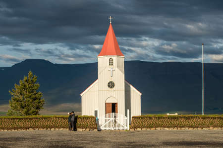 tourists stop: Glaumbaer, Iceland - August 16, 2016: Tourists take photos at Glaumabaer church. This is a popular tourist stop between Saudarkrokur and Varmahlid in Iceland.