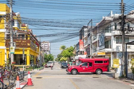 red truck: Chiang Mai, Thailand - February 3, 2016: Iconic traditional red truck taxi roaming the streets of Chiang Mai. Chiang Mai is a major tourist destination in northern Thailand.