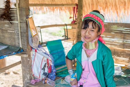 neck girl: Chiang Rai, Thailand - February 4, 2016: Karen long neck girl in a village between Chiang Rai and Chiang Mai. Karen is one of several ethnic hill tribes in northern Thailand Editorial