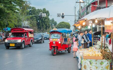 red truck: Chiang Mai, Thailand - February 6, 2016: Iconic traditional red truck taxi and tuk tuk roaming the streets of Chiang Mai. Chiang Mai is a major tourist destination in northern Thailand. Editorial