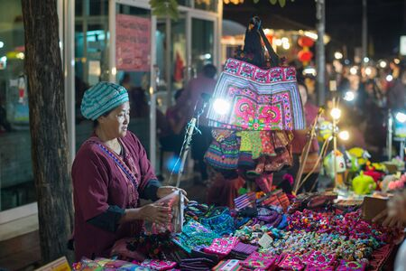 Chiang Mai, Thailand - February 7, 2016: Sunday night market walking street in Chiang Mai, Thailand. Chiang Mai is a major tourist destination in northern Thailand. Editorial