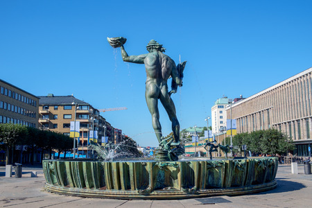 Gothenburg, Sweden – September 4, 2014: The iconic statue of Poseidon at Gotaplatsen in Gothenburg. This sculpture by Carl Milles has become a symbol for Gothenburg. Reklamní fotografie - 68685011