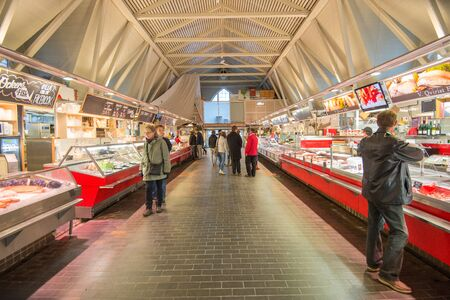 "Gothenburg, Sweden - November 16, 2013: Feskekorka or ""Fish church"" during November in Gothenburg. Feskekorka is a famous iconic indoor fish market in Gothenburg. Editorial"