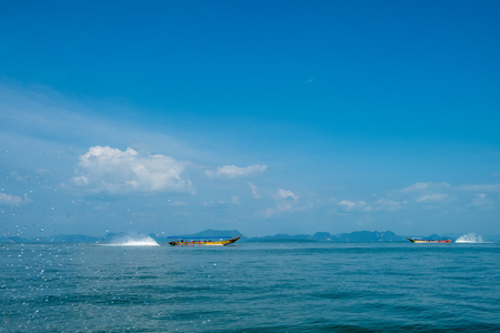 Tour boats cruising in Phang Nga Bay. This is one of Thailands most iconic tourist destinations.