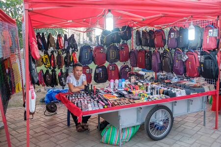 laotian: Vientiane, Laos - February 8, 2017: The night market in Vientiane. The famous night market is a major tourist attraction in the capital of Laos.