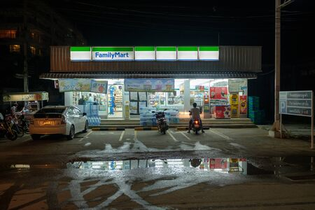 Hua Hin, Thailand - January 17, 2017: Street scene at night in Hua Hin after heavy rain during daytime. The wet season in Thailand was delayed in 2016 with heavy rains continuing into January 2017.