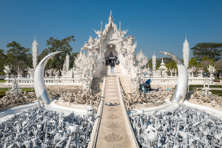 Chiang Rai, Thailand - February 4, 2016: Famous ornate Wat Rong Khun (White Temple) in Chiang Rai northern Thailand. This unconventional Buddhist temple is an ongoing project. Editorial
