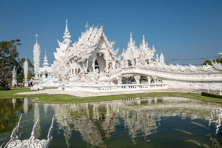 ongoing: Chiang Rai, Thailand - February 4, 2016: Famous ornate Wat Rong Khun (White Temple) in Chiang Rai northern Thailand. This unconventional Buddhist temple is an ongoing project. Editorial