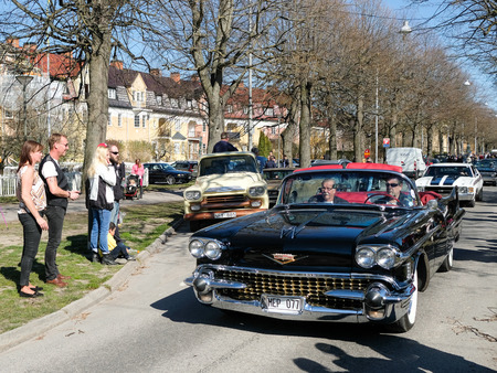 become: Norrkoping, Sweden - May 1, 2017: Cadillac Series 62, 1958, at the traditional vintage car parade celebrating spring on May Day in Norrkoping. This parade started in 1974 and has become an annual tradition in Norrkoping on May 1.