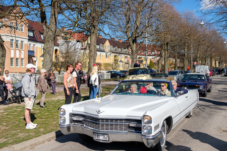 become: Norrkoping, Sweden - May 1, 2017: Cadillac De Ville, 1966 at the traditional vintage car parade celebrating spring on May Day in Norrkoping. This parade started in 1974 and has become an annual tradition in Norrkoping on May 1.