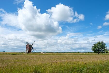 "Traditional windmill on Swedish island Oland in the Baltic Sea. Windmills are a common sight on Oland, which is nicknamed ""the island of the sun and winds""."