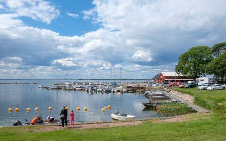 Stora ror, Sweden - July 15, 2017: Stora ror harbor at Kalmar strait on Swedish Baltic sea island Oland. Oland is a popular tourist destination in Sweden during summertime. Editorial