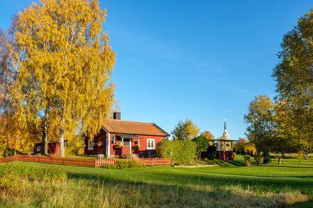 Vikbolandet, Sweden - October 19, 2018: Traditional red cottage  in the countryside of Vikbolandet. Vikbolandet is an old agricultural area in Sweden.