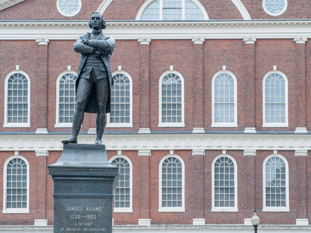 Boston, USA - June 23, 2010: Samuel Adams statue in front of Faneuil Hall, which was built in 1743 and is one of the most visited tourist sites in USA.