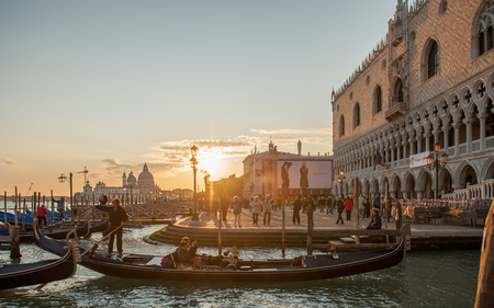 Venice, Italy - October 22, 2011: Venetian sunset at Doge's Palace in San Marco. The oldest parts of the palace were established 1340.