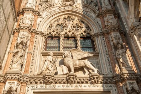 Venice, Italy - October 23, 2011: Exterior details of Doge's Palace in San Marco, Venice. The oldest parts of the palace were established 1340.