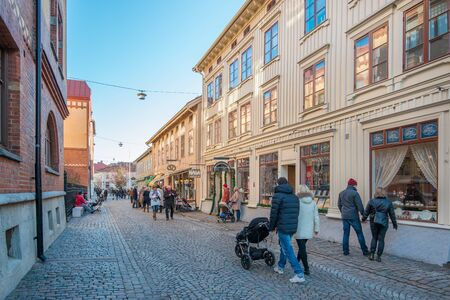 Gothenburg, Sweden - November 17, 2013: People stroll the streets of Haga in Gothenburg. Haga is a historic residential area, which has become fashionable and popular among tourists.