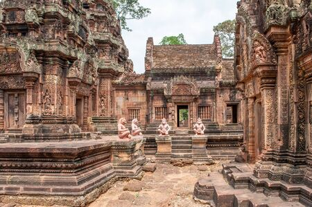 Banteay Srei, a 10th century Hindu temple dedicated to Shiva. The temple built in red sandstone was forgotten for centuries and rediscovered 1814 in the jungle of the Angkor area of Cambodia. Editorial