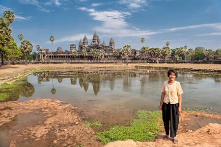 Siem Reap, Cambodia - March 10, 2009: Khmer woman posing at Angkor Wat in Siem Reap, Cambodia. Angkor Wat is a 12th century temple. Editorial