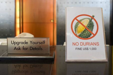 Durian is an expensive but controversial tropical fruit in Southeast Asia due to its strong smell and it is forbidden in many public places like in this Bangkok hotel Stock Photo - 92542801