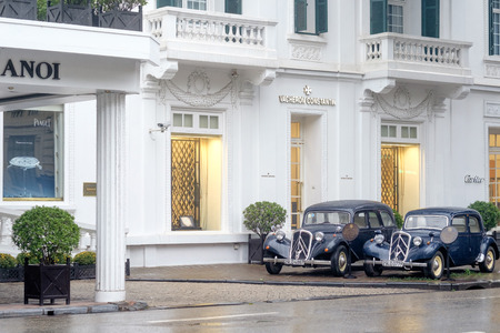 Hanoi, Vietnam - February 11, 2015: Metropole Hotel in Hanoi on a rainy day in February. This classic hotel built in French colonial style the hotel opened in 1901 and has welcomed numerous celebrities since then.