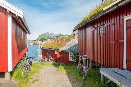 Reine, Norway - July 5, 2011: Typical rorbu cottages in Lofoten. These traditional seasonal cottages used by fishermen have been modernized to be used by tourists.