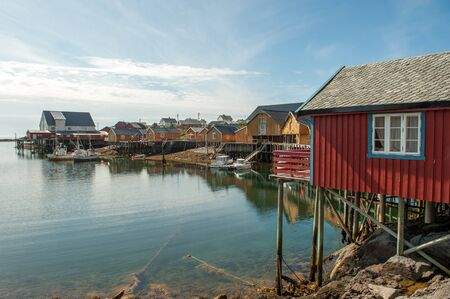 Tind, Norway - July 5, 2011: Typical rorbu cottages in Lofoten. These traditional seasonal cottages used by fishermen have been modernized to be used by tourists.
