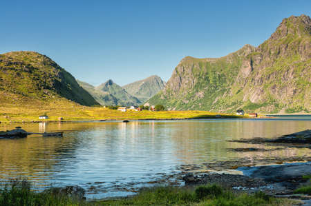Traditional rural buildings in coast landscape on Lofoten islands in northern Norway. Lofoten is a popular tourist destination.