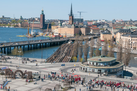 Stockholm, Sweden - May 1, 2009: Aerial view from Katarina elevator during a demonstration at Slussen traffic hub on International Worker's day.  The Old Town and Stockholm City Hall visible in the background.