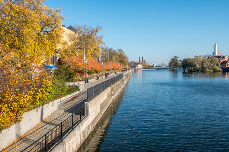 Norrkoping, Sweden - October 14, 2018: Norrkoping waterfront Saltangen and Motala stream during a warm and sunny autumn day. Norrkoping is a historic industrial town in Sweden.