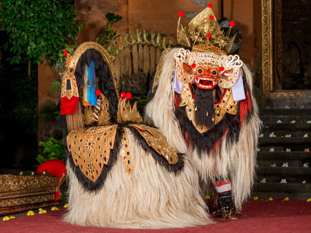 Bali, Indonesia - February 6, 2013: Traditional Barong dance in an old Hindu temple in Bali. Barong is a lion like creature in Balinese mythology. Editorial