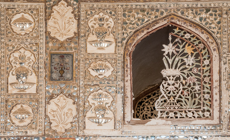 Jaipur, India - February 2, 2011: Broken window at Sheesh Mahal, the Mirror Palace, a famous palace in the third courtyard of Amer Fort in Jaipur. Amer Fort or Amber Fort is a a UNESCO World Heritage site.