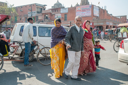 Jaipur, India - February 2, 2011: Pedestrians in the morning traffic of Japiur, which is the largest city in Rajasthan with a population of 3-4 million. Stock Photo - 120754547