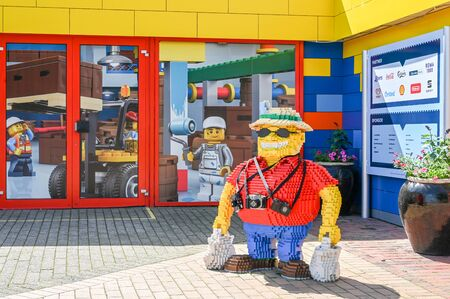 Billund, Denmark - June 7, 2019: Lego tourist at Legoland in Billund. This family theme park opened in 1968 and is built by 65 million lego bricks.