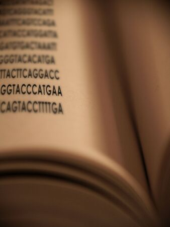 heredity: Genetic Code is revealed in an open book