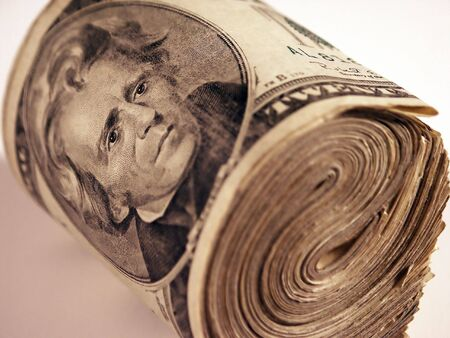 A large roll of US twenties Stock Photo