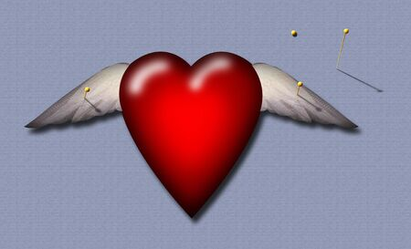A winged heart lies pinned to a surface Banco de Imagens