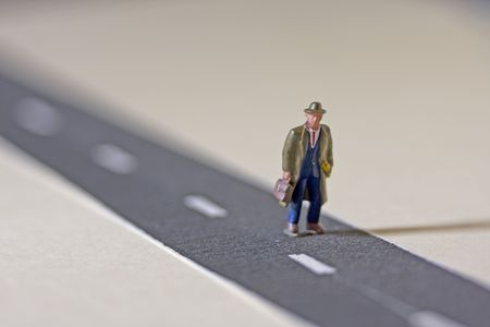 minature: Man on road shallow depth of field